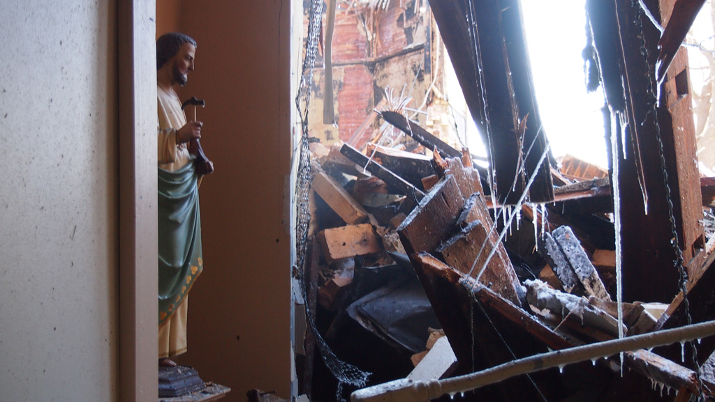 Saint Joseph statue in burnt out hallway