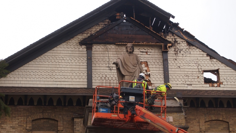 Saving the Saint Joseph statue above the entrance